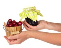Fresh berries and jam in hands Stock Photography