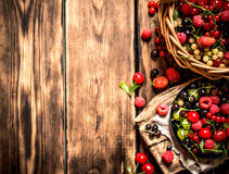 Fresh berries in an old basket. On wooden table. Fresh berries in an old basket. On a wooden table Royalty Free Stock Image