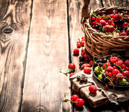 Fresh berries in an old basket. On wooden table. Royalty Free Stock Photography