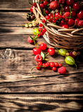 Fresh berries in an old basket. On wooden table. Fresh berries in an old basket. On a wooden table Stock Photography