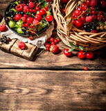Fresh berries in an old basket. On wooden table. Stock Photos