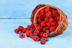 Fresh berries in an old basket. On wooden table. Royalty Free Stock Photos