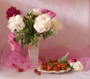 Fresh berries and peonies Royalty Free Stock Image