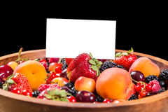Fresh berries in plate with blank card Stock Photos