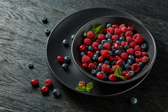 Fresh berries on plate Royalty Free Stock Photo