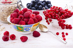 Fresh berries raspberries, yogurt and homemade granola for breakfast, top view, horizontal Royalty Free Stock Images
