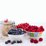 Fresh berries raspberries, yogurt and homemade granola for breakfast, top view, square Stock Photography