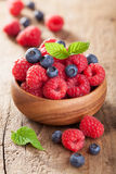 Fresh berries raspberry blueberry in wooden bowl stock image
