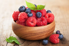 Fresh berries raspberry blueberry in wooden bowl Stock Photography