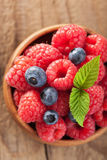Fresh berries raspberry blueberry in wooden bowl.  Stock Images