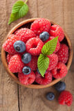Fresh berries raspberry blueberry in wooden bowl.  Stock Photography