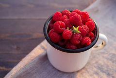 Fresh berries of raspberry in an iron mug Stock Image