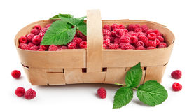 Fresh berries raspberry in wicker basket. With green leaves. On white background Stock Photography