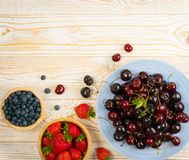 Fresh Berries on Rustic Wooden Background royalty free stock images