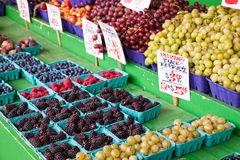 Fresh berries and grapes for sale at a farmer`s market. Fresh berries for sale at a farmer`s market Royalty Free Stock Image