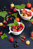 Fresh Berries on Slate Background (Strawberries, Raspberries and Royalty Free Stock Image