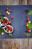 Fresh Berries on Slate Background (Strawberries, Raspberries and Royalty Free Stock Images