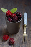 Fresh berries. In small bucket on wooden background Stock Photography