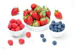 Fresh berries - strawberries, raspberries, blueberries in bowl. Fresh berries - strawberries, raspberries and blueberries in bowls on a white background Stock Photos