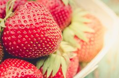 Fresh berries of strawberry closeup/Top view. Strawberry in wooden basket royalty free stock image