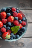 Fresh berries top view. Variety of fresh summer berries. Strawberry, raspberries, blueberries, top view Stock Images