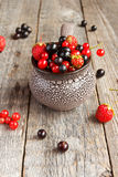 Fresh berries. Various summer berries in a bowl on rustic wooden table. Royalty Free Stock Photos