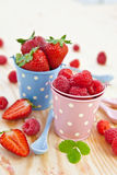 Fresh berries in vintage buckets. Fresh berries in little vintage buckets Royalty Free Stock Photography