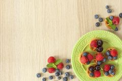Fresh berries on waffles Stock Photography