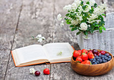 Fresh berries white bouquet and  open  book Stock Image