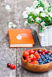 Fresh berries white bouquet and  open book Royalty Free Stock Photo