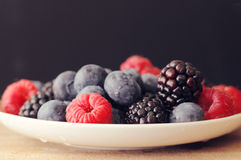 Fresh berries on a white plate Royalty Free Stock Image