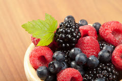 Fresh berries in wood bowl Royalty Free Stock Photography