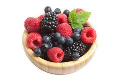 Fresh berries in wood bowl isolated. Over white background Royalty Free Stock Image