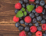 Fresh berries on wood Royalty Free Stock Photo