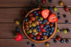 Fresh Berries on Wooden Background Stock Image