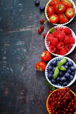 Fresh Berries on Wooden Background. Strawberries, Raspberries an Royalty Free Stock Photo