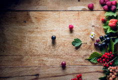 Fresh berries on wooden background table Stock Photos