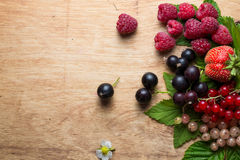 Fresh berries on wooden background table Royalty Free Stock Image