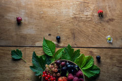 Fresh berries on wooden background table Royalty Free Stock Images