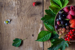 Fresh berries on wooden background table Royalty Free Stock Photography