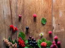 Fresh berries on wooden background table Royalty Free Stock Photo