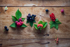 Fresh berries on wooden background table Royalty Free Stock Photos