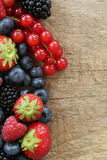 Fresh berries on a wooden board Stock Photo
