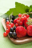 Fresh berries in wooden bowl Stock Photo