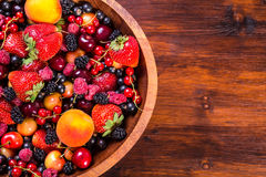 Fresh berries on wooden bowl Royalty Free Stock Photo