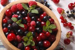 Fresh berries in a wooden bowl closeup. horizontal Royalty Free Stock Images