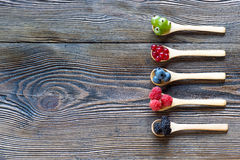 Fresh berries in wooden spoon on a rustic wooden table. Berries in wooden spoons on wooden background. Raspberries, Blueberries Health and Diet, Gardening Stock Photography