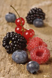 Fresh berries on a wooden table Stock Photos