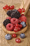Fresh berries on a wooden table Royalty Free Stock Images