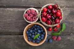Fresh berries on a wooden table Royalty Free Stock Image